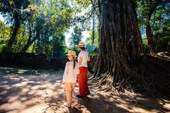 Ta Som temple. Family visiting ancient Ta Som temple in Angkor Archeological area in Cambodia Royalty Free Stock Photos
