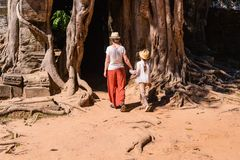 Ta Som temple. Family visiting ancient Ta Som temple in Angkor Archeological area in Cambodia Royalty Free Stock Image