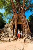 Ta Som temple. Family visiting ancient Ta Som temple in Angkor Archeological area in Cambodia Royalty Free Stock Photography