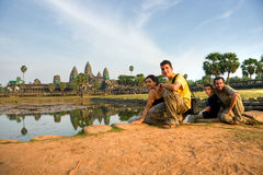 Family visiting Angkor Wat at sunset, cambodia. Royalty Free Stock Photo