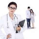 Family visiting an obstetrician Stock Photos