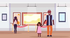 Family visitors in modern art gallery museum interior african american grandfather with granddaughter looking royalty free stock image