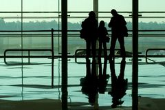 Family waiting airport. Family waiting at the international airport terminal stock image