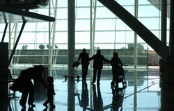 Family waiting at the airport Royalty Free Stock Images