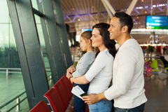 Family waiting airport Stock Photography