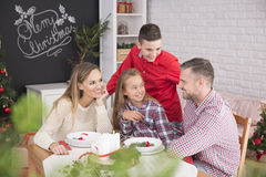 Family waiting for christmas dinner Royalty Free Stock Photos
