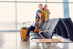 Family waiting for departure at airport royalty free stock image