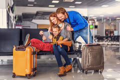 Family waiting for departure at airport royalty free stock photography