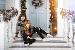 Family waiting for New year and Christmas. Mom and daughter in cozy home, decorated entrance to house with bright colours. Family waiting for New year. Family Royalty Free Stock Photo