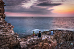 Family is Waiting for Sunset over the Sea Royalty Free Stock Images