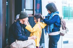 Family waiting to go inside of the famous Tempura japanese restaurant royalty free stock photography