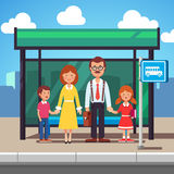 Family waiting for transit on a city bus stop. Family husband and wife with kids boy and girl waiting for transit on a city bus stop. Colorful flat style cartoon Royalty Free Stock Images
