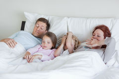 Family waking up Royalty Free Stock Image