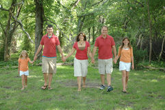 Family walk. A family of five holding hands and taking a walk in the woods Stock Photos