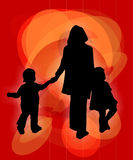 Family walk. Silhouette of a woman walking with children Royalty Free Stock Photos