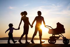 Family Walk At Sunset Royalty Free Stock Photography
