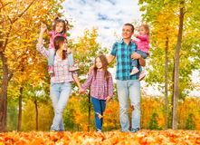 Family walk in the autumn park holding hands Royalty Free Stock Images