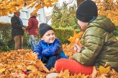 Family on walk in the autumn season. Family poses in an autumn garden Stock Photography