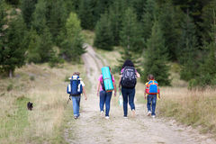 Family walk with backpacks from back Royalty Free Stock Photo