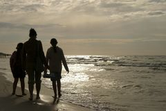 family walk on beach Stock Photo
