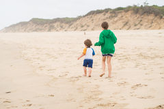 Family walk on the beach Stock Photo