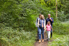 Family On Walk Through Beautiful Countryside Royalty Free Stock Images