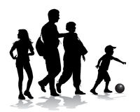 Family on walk. Family on a walk with the children in the urban park Royalty Free Stock Images