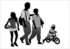 Family on walk. Family on a walk with the children in the urban park Royalty Free Stock Image
