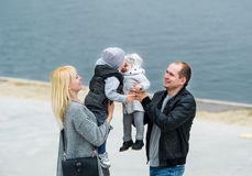 Family walk in city park. Royalty Free Stock Images