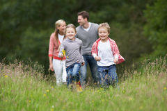 Family On Walk In Countryside Stock Photography