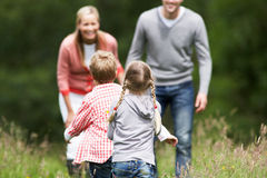 Family On Walk In Countryside Stock Photos