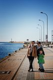 Family walk on Darlowo pier. Family of three women walking on Darlowo (Poland) pier Royalty Free Stock Images
