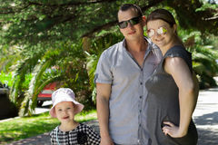 Family on walk in hot day Royalty Free Stock Photography