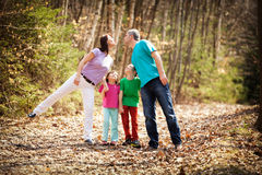 Family walking in forest Royalty Free Stock Images