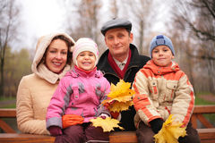Family on the walk with maple leaves. Family on the walk with autumnal maple leaves Stock Photography