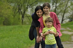 Family for a walk. Mother and children. Walk, fun Stock Photography