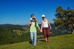 Family walk in mountains Stock Photo