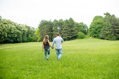 Family walk in nature. Trough the grass Royalty Free Stock Photography