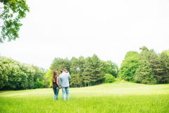 Family walk. In nature, trough the grass Stock Photos