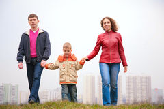 Family walk outdoor in city. On spring Royalty Free Stock Photos