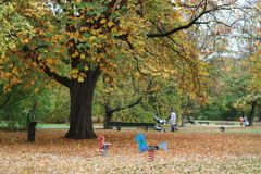 Family walk in the park. Children's park. Family walking at the distance. It's autumn in Germany Royalty Free Stock Photos