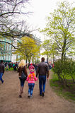 Family on a walk in park in spring. A family on a walk in a park in spring Stock Photography