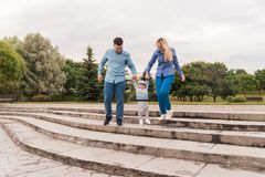 Family walk in the park. Family walks in the park. Man, woman and child in nature stock photo