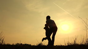 Family walk silhouetted swinging son stock footage