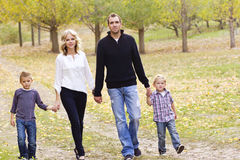 Family on a walk together. A cute young family talking a nice walk together outside Stock Photo