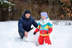 Family walk in winter forest dad mom and child stock photos