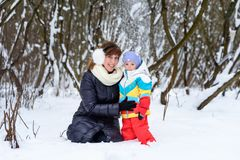 Family walk in winter forest dad mom and child royalty free stock images