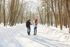 Family walk in a winter park Royalty Free Stock Photo