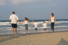 Family Walking. Family of 5 walking towards the ocean Royalty Free Stock Photos