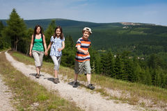 Family walking Royalty Free Stock Photos